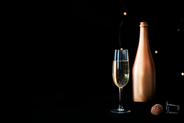 Champagne bottle with glass