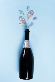 Champagne bottle with glitter splashes