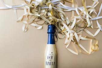Champagne bottle with ribbons on table