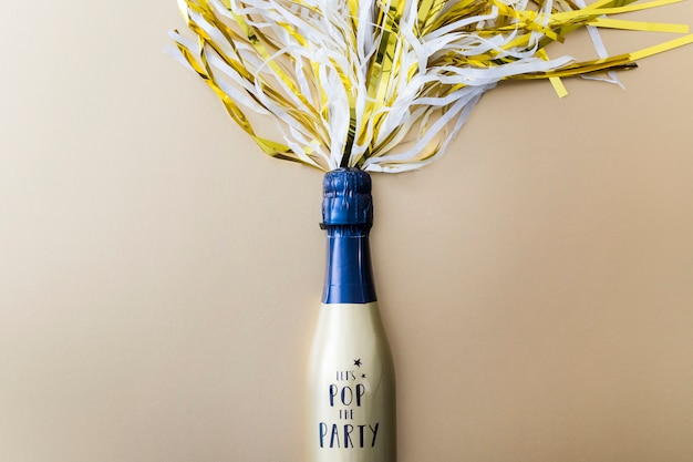 Champagne bottle with tinsel on table