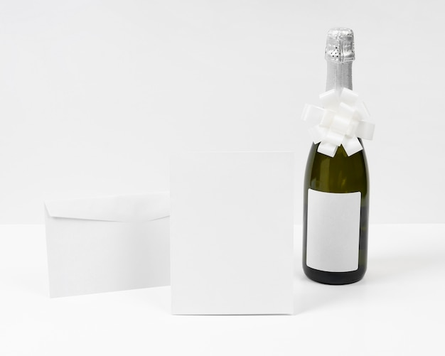 Champagne bottle with white bow