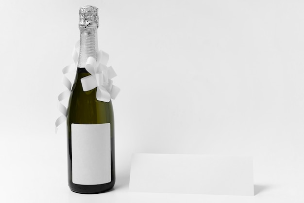 Champagne bottle with white ribbon