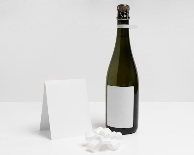 Champagne bottles with white bow