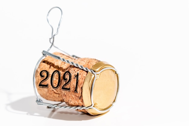 Champagne cork with year 2021 on white surface