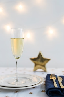 Champagne glass on plate with star
