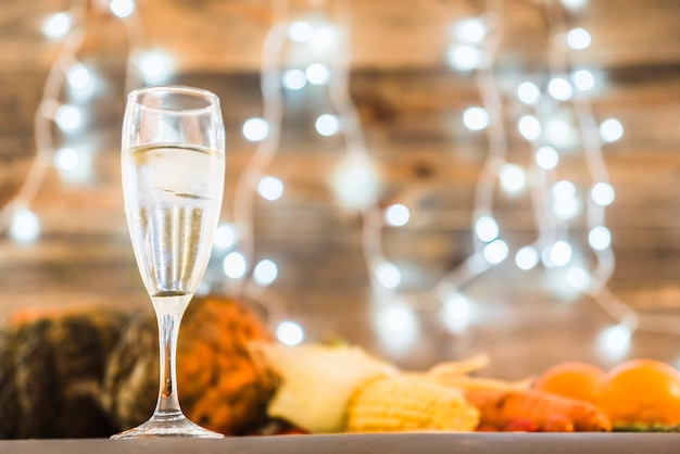 Champagne glass on table with vegetables