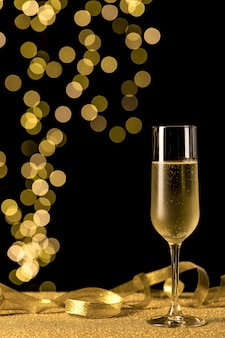 Champagne glass with bokeh lights