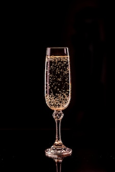 Champagne glass with bubbles with reflection
