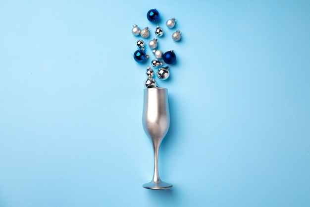 Champagne glass with christmas balls