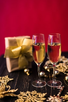 Champagne glass with gift boxes and christmas decorations. present for special one.