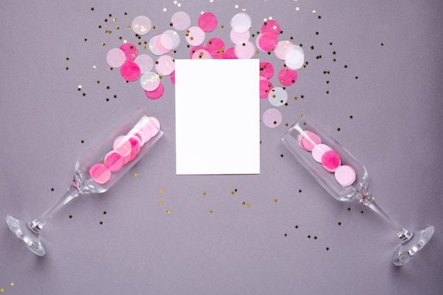 Champagne glasses and card with pink confetti