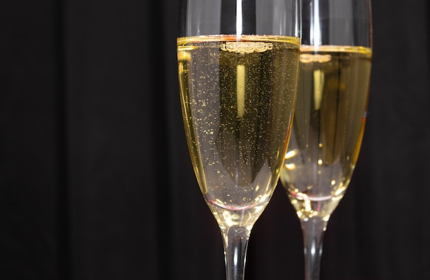Champagne glasses on a dark blue
