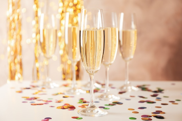 Champagne glasses on decorated space, space for text