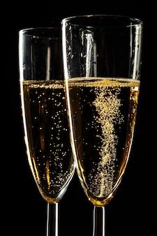 Champagne glasses for festive occasion against a dark