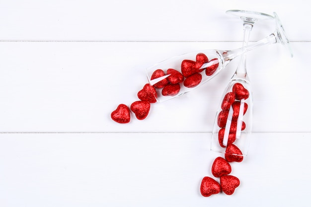 Champagne glasses filled with hearts
