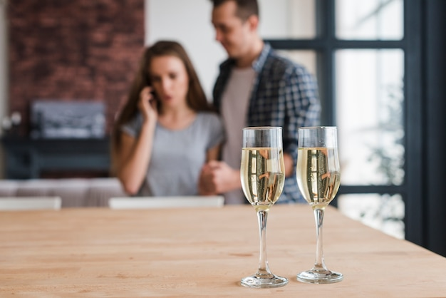 Champagne glasses on table prepared for couple