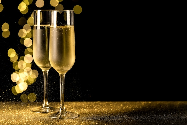 Champagne glasses with bokeh lights