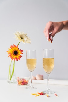 Champagne glasses with flowers on the table