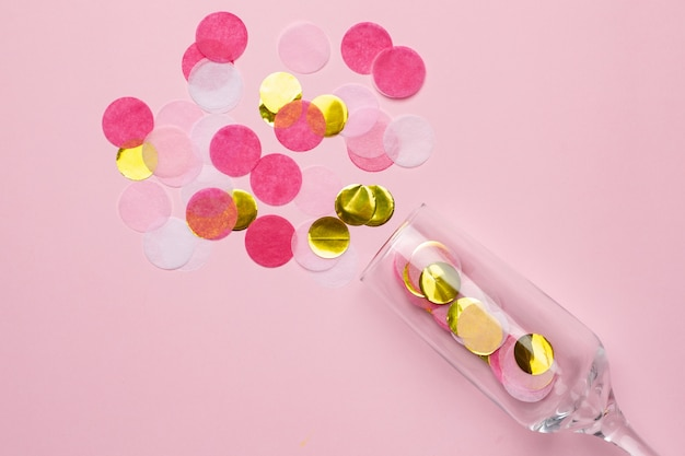 Champagne glasses with golden and pink confetti