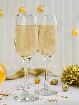 Champagne glasses with golden tinsel