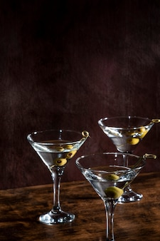 Champagne glasses with olives