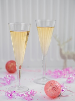 Champagne glasses with pink ribbon