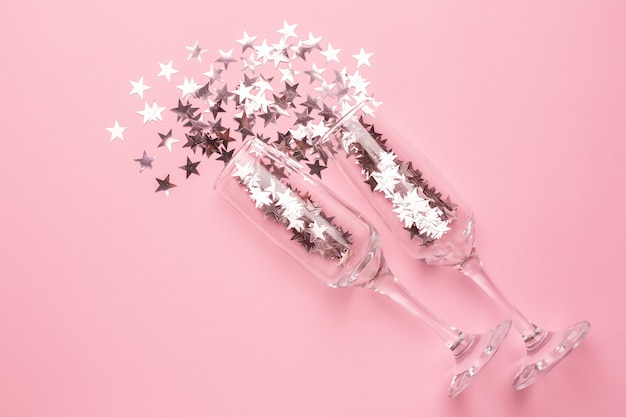 Champagne glasses with silver and pink stars