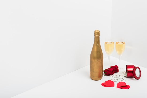 Champagne glasses with small paper hearts