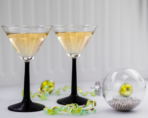 Champagne glasses with transparent globe