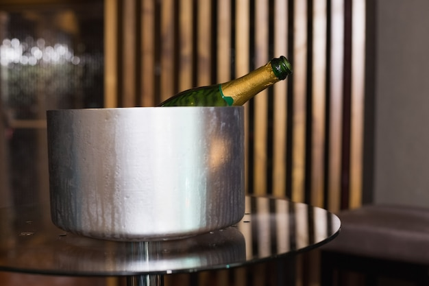 Champagne in an ice bucket at the bar