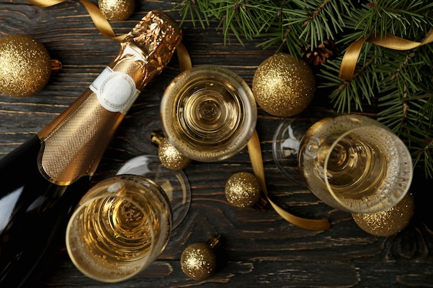 Champagne and new year accessories on wooden table