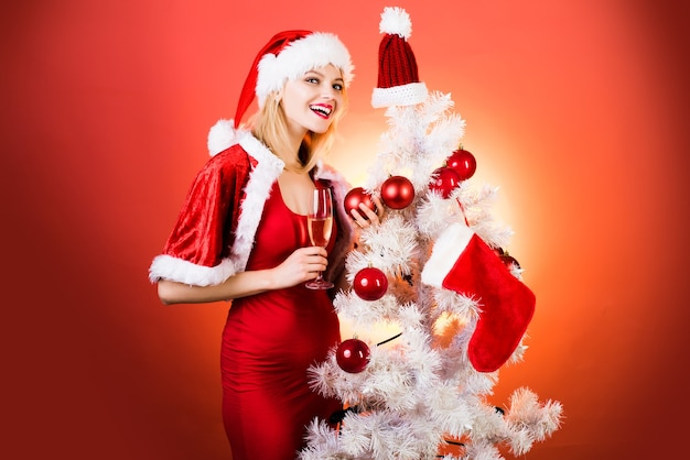 Champagne new year party pretty girl wish merry christmas and happy new year christmas girl concept ...