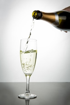 Champagne pouring into flute