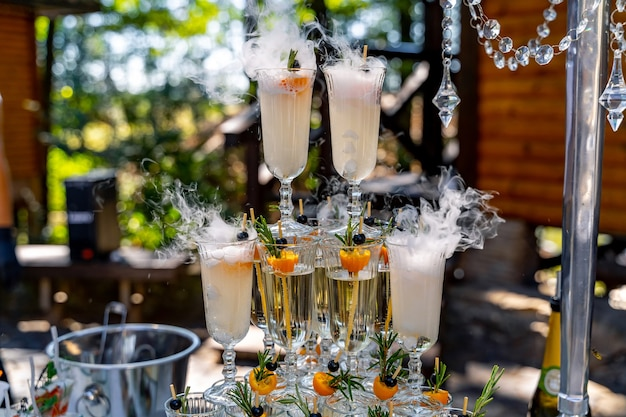 Champagne slide. pyramid or fountain made of champagne glasses. wedding table decoration.