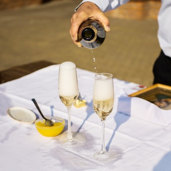 Champagne and wine glasses, alcohol, pouring champagne, wedding table,
