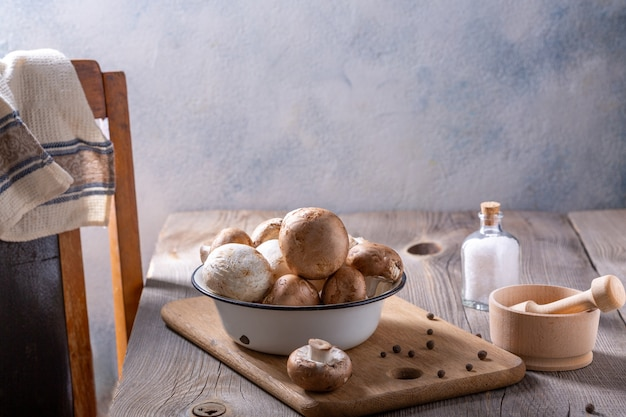 Champignon mushrooms and spices on a wooden table. cooking concept