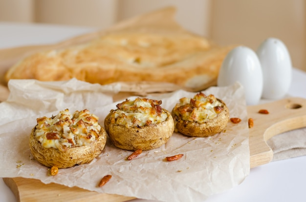 Champignon mushrooms stuffed  with cheese,chicken, herbs baked in oven and georgian bread
