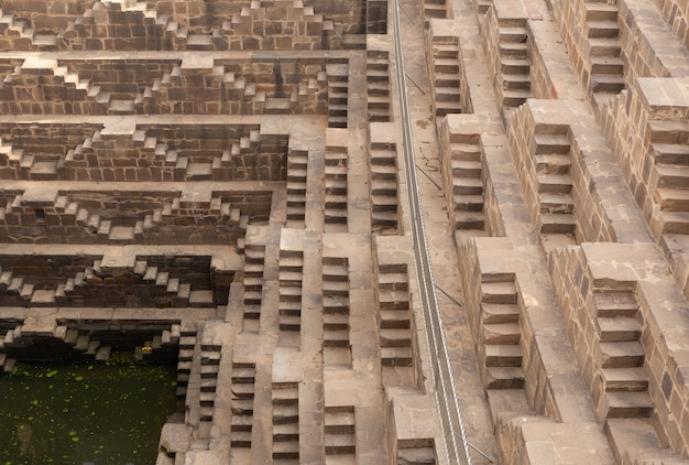 Chand baori stepwell situated in the village of abhaneri near jaipur india.
