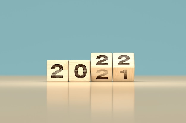 Change 2021 to 2022 happy new year concept - wooden cubes - 3d render
