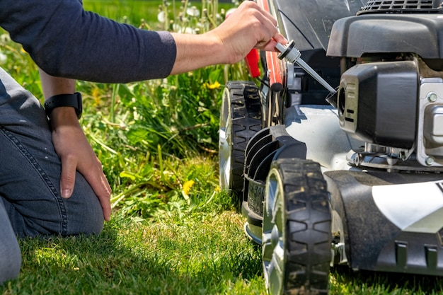 Change and check the oil in the motor lawn mower