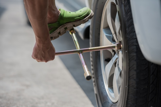 Changing a car tire, close up , car fixing and mainance service.