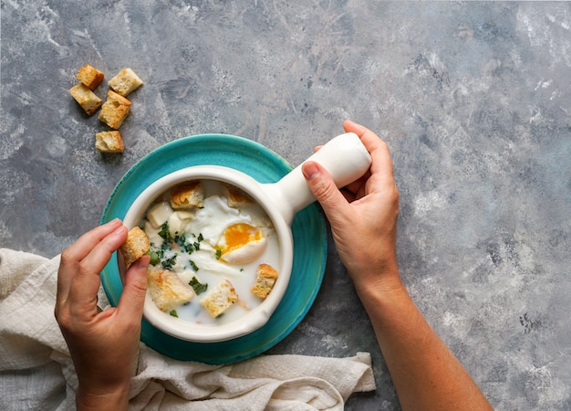 Changua - colombian egg and milk soup , tipical soup for breakfast in bogota