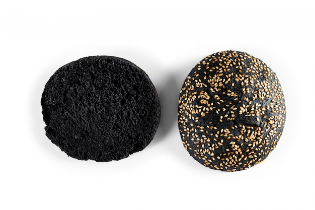 Charcoal bread, black bread isolated on white background.
