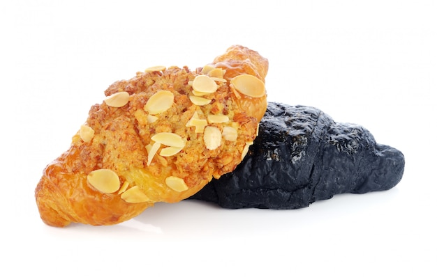 Charcoal croissant and almond on white background