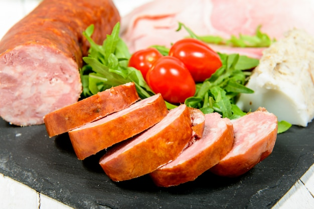 Charcuterie plate with bread and tomatoes