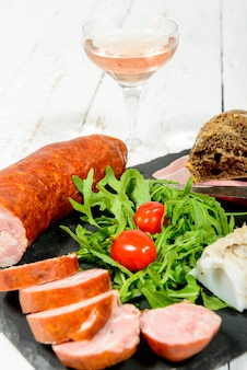 Charcuterie plate with wine