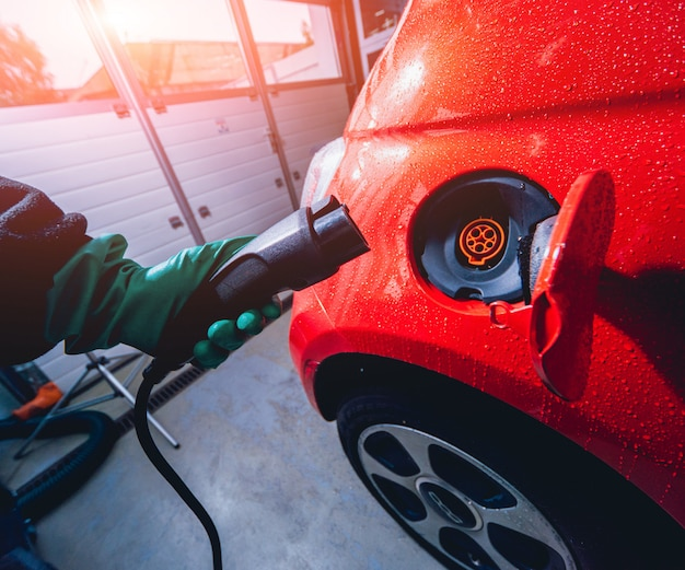 Charging an electric vehicle in the car service. future of the automobile