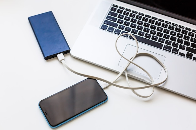 Charging of smartphone and a laptop
