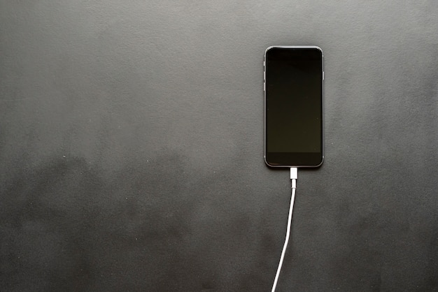 Charging wire inserted in smartphone isolated