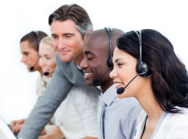 Charismatic manager and his team working in a call center